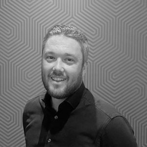 A headshot of Charlie Rowland, Tillr's Sales Director in black and white