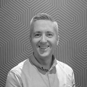 A headshot of Danny Callaghan, Tillr's Head of Engineering in black and white