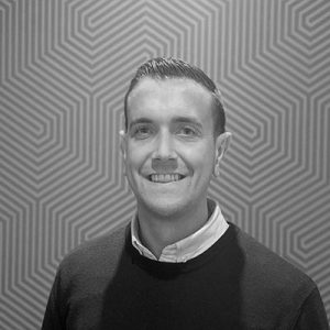 A headshot of Jamie Wilson, Tillr's Head of Customer Success in black and white