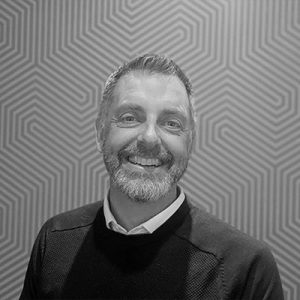 A headshot of Jonathan Clark, Tillr's Alliances & Partnerships Manager in black and white