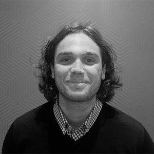 A headshot of Tom Gillingham, Tillr's Business Development Manager in black and white
